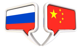 The dialog between the Russian Federation and China. Dialog clouds with flags of the Russian Federation and China. The three-dimensional illustration. Isolated Royalty Free Stock Image