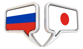 The dialog between the Russian Federation and Japan. Dialog clouds with flags of the Russian Federation and Japan. The three-dimensional illustration. Isolated Royalty Free Stock Photography