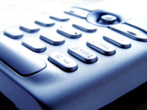 Dialogue. Closeup of a mobile phone keypad, in slightly overexposed look Royalty Free Stock Images