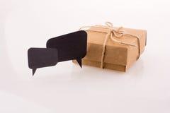 Dialogue boxes near a carton box Royalty Free Stock Image