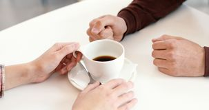 Furious. Angry man fist hit the table. Dialogue hands men and women communicate at the table with a cup of coffee. The boss beats his fist the table Royalty Free Stock Images