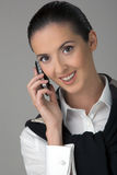 Dialogue by a mobile phone. The young beautiful woman  smiling, speaks by phone Stock Image