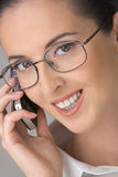 Dialogue by a mobile phone. The young beautiful woman in points, smiling, speaks by phone Royalty Free Stock Image