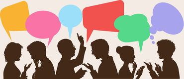 Dialogue. Silhouettes of people leading dialogues with colorful speech bubbles royalty free illustration