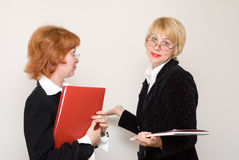Dialogue of two business women. Royalty Free Stock Image