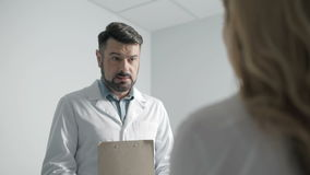Dialogue between two medical professionals stock footage