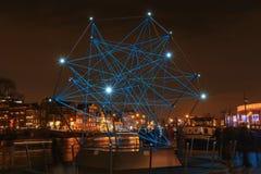 Diamant av ljus som svävar på floden Amstelen i Amsterdam Royaltyfria Bilder