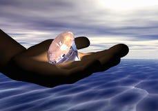Diamant in der Hand Lizenzfreie Stockbilder