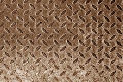 Diamant formad metallgolvmodell i brun signal Royaltyfri Bild