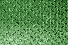 Diamant formad metallgolvmodell i grön signal Royaltyfria Bilder
