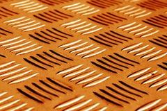 Diamant formad metallgolvmodell med suddighetseffekt i apelsin till Royaltyfri Foto