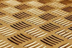Diamant formad metallgolvmodell med suddighetseffekt i brun ton Arkivbild