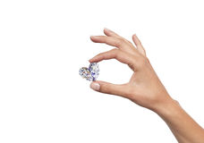 Diamant i handen royaltyfri bild