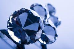 Diamant op blauwe achtergrond Stock Foto