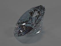 Diamante brillante su un fondo grigio, vista laterale Fotografia Stock Libera da Diritti