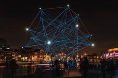 Diamante de la luz que flota en el río el Amstel en Amsterdam Imagen de archivo libre de regalías