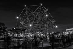 Diamante de la luz que flota en el río el Amstel en Amsterdam Fotografía de archivo