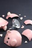 Diamante em um banco Piggy fotografia de stock