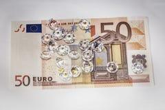 Diamanten over een bankbiljet Royalty-vrije Stock Foto's
