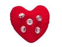 diamantes 3d en el terciopelo rojo Foto de archivo libre de regalías