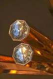 Diamantes en barra de oro Imágenes de archivo libres de regalías