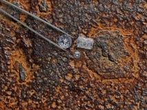 Diamantes sobre la placa oxidada Fotos de archivo libres de regalías