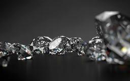 Diamanti su fondo grigio scuro Fotografia Stock