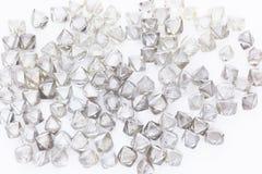 Diamanti trasparenti naturali su un bianco Immagini Stock