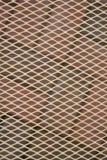 Diamantmuster überlagerte über einem Ziegelsteinpatiohintergrund Stockfotografie