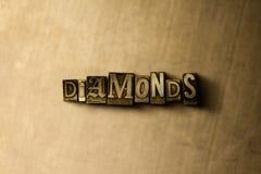 DIAMANTS - plan rapproché de mot composé par vintage sale sur le contexte en métal Photographie stock libre de droits