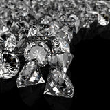 Diamants sur la surface noire Images stock