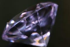 Diamond. A clear purple diamond on black Royalty Free Stock Images