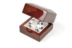 Diamond. Big diamond in wooden box isolated on white Royalty Free Stock Photos