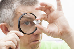 Diamond. Jeweler looking intrigued at a diamond Royalty Free Stock Photos