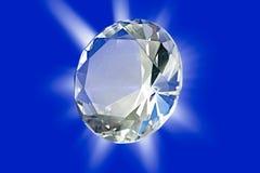 Diamond. A photo of a diamond on a blue background with star burst Stock Photo