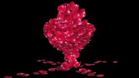 Diamond attracting rose petals, camera rotating, against black, stock footage stock video footage