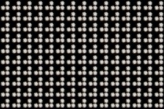 Diamond background. Round brilliant cut diamonds grid isolated on black background Stock Image