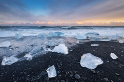 Diamond beach, Jokulsarlon - Iceland. Stunning view at sunset from the `Diamond beach` near Jokulsarlon, Iceland Royalty Free Stock Photo