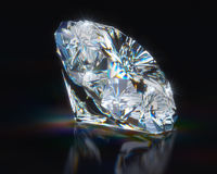 Diamond on black reflective background Royalty Free Stock Images