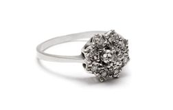 Diamond Blossom Silver Ring. Macro shot of a jeweled silver ring isolated on white Royalty Free Stock Photo