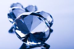 Diamond on blue background Stock Photo
