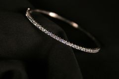 Diamond Bracelet. On a black cloth Royalty Free Stock Photography