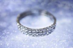 Diamond bracelet on a mirror blurred blue background Stock Photos