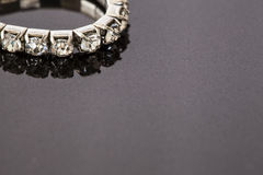 Diamond bracelet on a stone surface Royalty Free Stock Photo