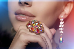 Diamond. Brilliant. Antique old vintage earrings and ring. Jewel. Ry on her finger at the girl close-up on a Stock Image