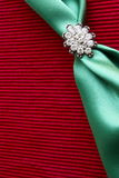 Diamond brooch- background. Diamond brooch on red textured background Royalty Free Stock Image