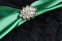 Diamond brooch- background. Diamond brooch on black lacy background Royalty Free Stock Photos