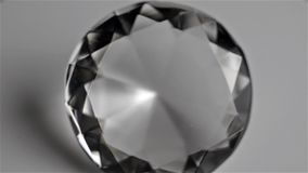 Diamond. Carved glass like a diamond spinning on itself. White background stock footage