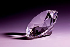 Diamond close-up in violet. With violet background Stock Images