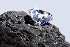 Diamond and Coal plain background. Royalty Free Stock Photography